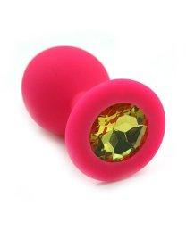 Силиконовая анальная пробка средняя розовая с жёлтым кристаллом
